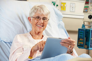 Lady using tablet in hospital