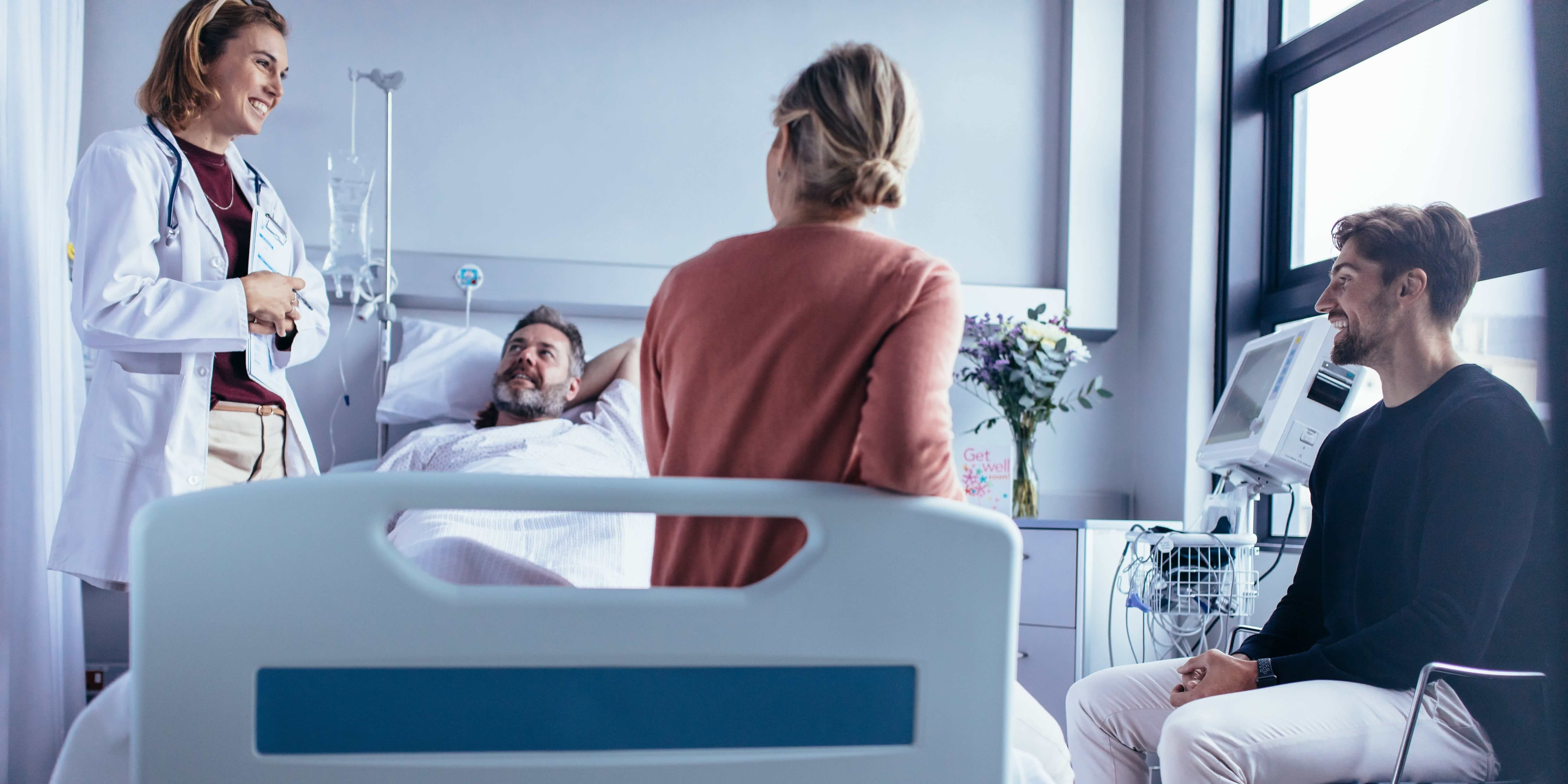 family and patient talking to doctor